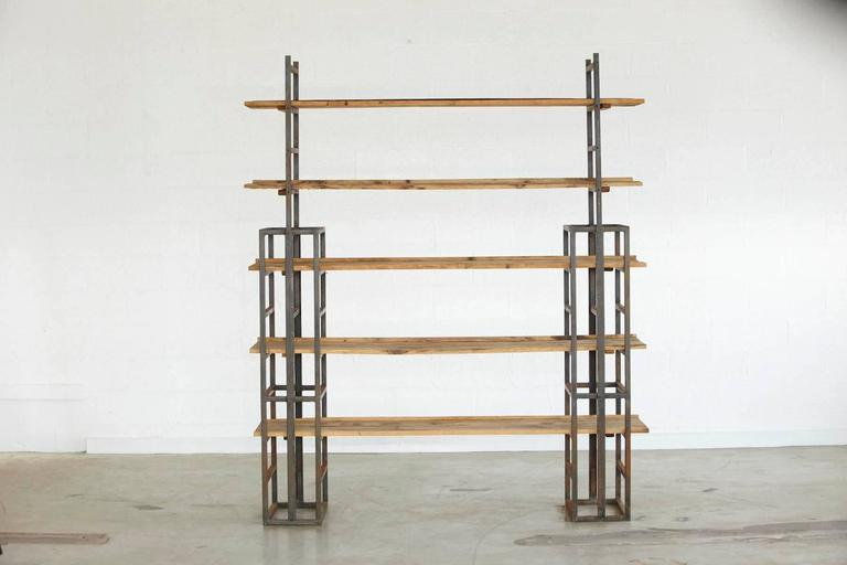 Custom-made Industrial style steel and five-tiered wood plank etagere.