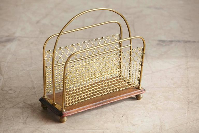 Rare and exquisite 19th century Aesthetic Movement Canterbury. Filigree woven brass bands, as slated partitions fixed on a wooden board with round brass legs. There is a tiny fissure in the wooden board, hardly visible, please refer to the
