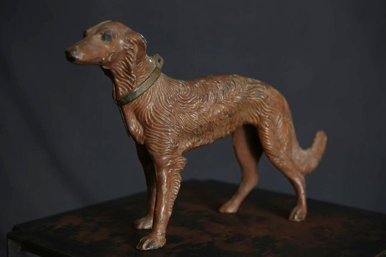 Beautiful Art Nouveau detailed cast iron, cold painted doorstop or object depicting a hunting dog. The dog has a great patina with some little paint loss which gives it a certain charm.