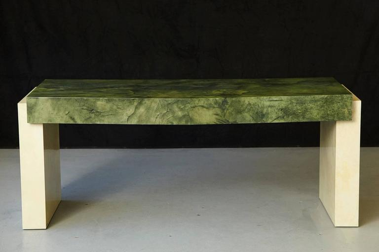 Exceptional large custom ordered desk by Karl Springer with a marbleized emerald green lacquered goatskin top and marbleized ivory lacquered base. Three drawers, the middle one has a removable pencil canoe. Exceptional detailed work and shades in