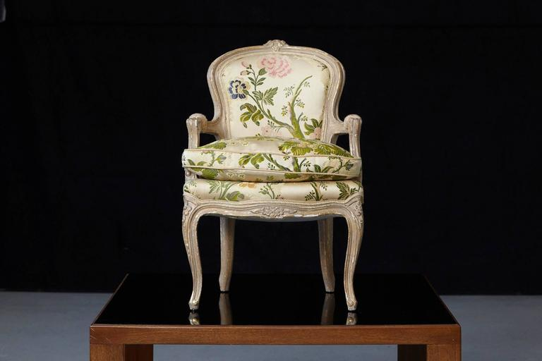 Cute little Louis XV style child's fauteuil from France, upholstered in a flowery chintz fabric by ABC Upholstery, in excellent condition.
