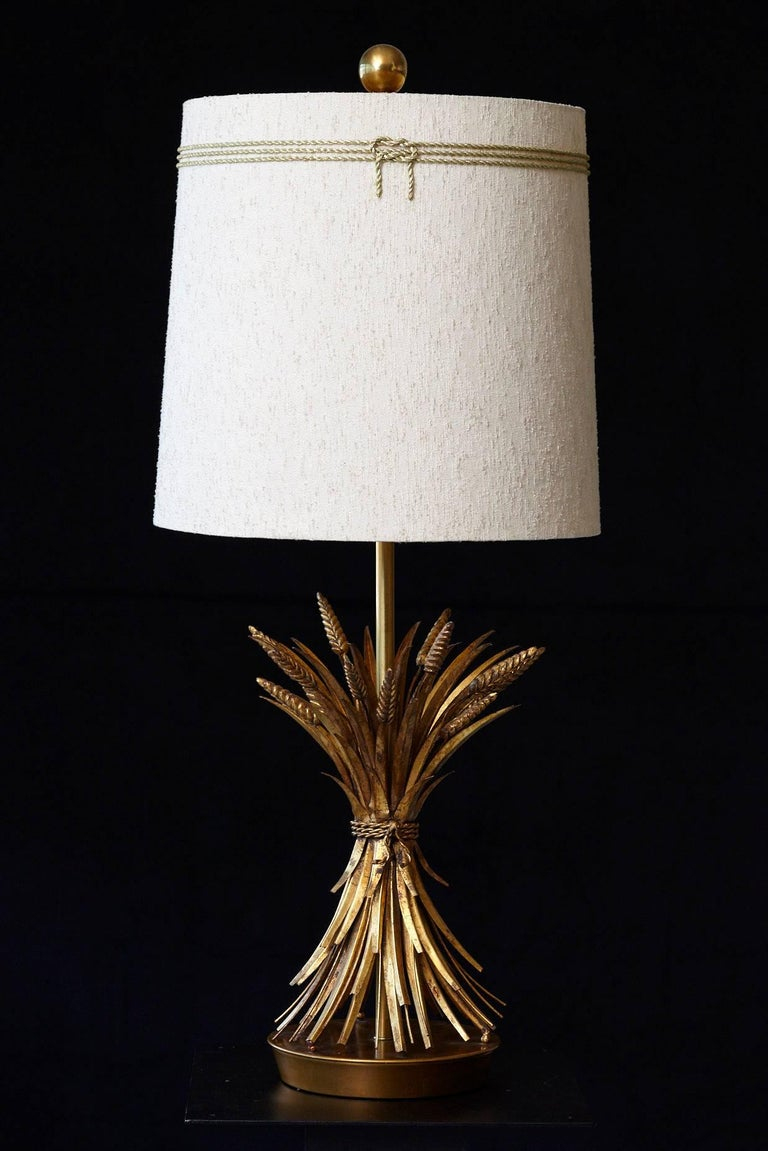 Impressive sheaf of wheat gilt metal table lamp by Marbro. The lamp has a brushed brass base and gilt tole metal wheat sheafs.  We have a second wheat sheaf table lamp available by the same manufacturer, the same model, which is slightly different