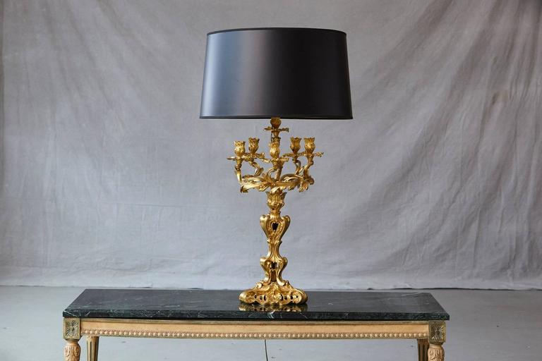 Gorgeous Louis XV style doré bronze candelabrum table lamp with six lights, foliate cast, now electrified and with a new black shade with gold colored lining. Can be purchased without shade, which would reduce the price by $ 80.  Measurements shade: