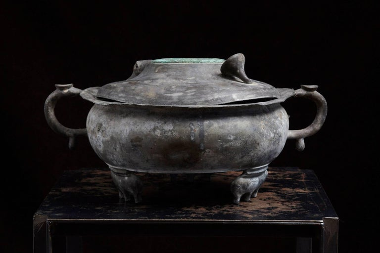 Antique Asian zinc cooking pot, probably some kind of a steamer cooking utensil, where you put charcoal in the small unit in the middle to heat up the surrounding pot.