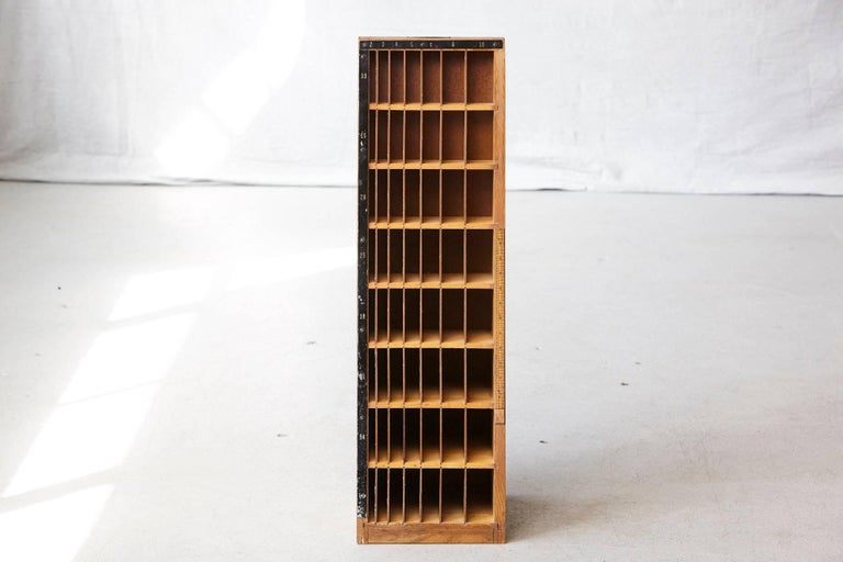 Unusual wooden furniture which has been used for the the storage of differently sized wood blocks. These wood blocks have been used for the letterpress as distance holders for headlines and articles.