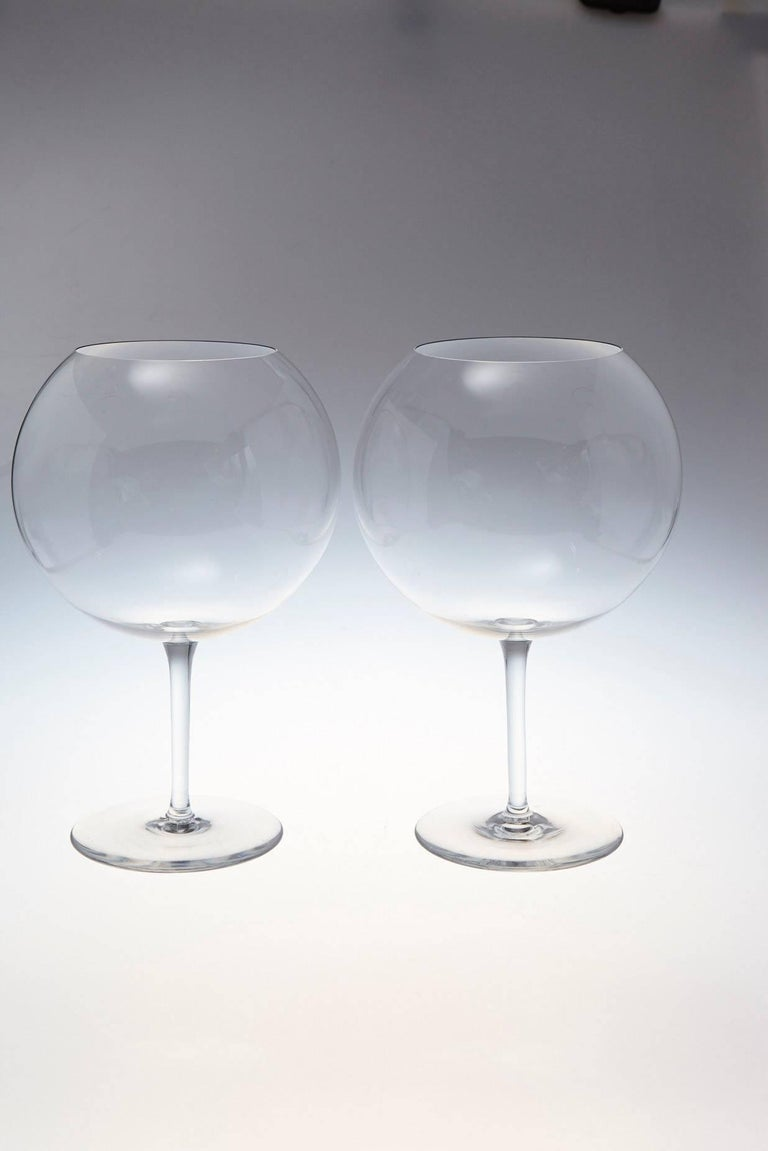 Two beautiful Baccarat crystal balloon shape tasting wine glasses with a striking Silhouette.