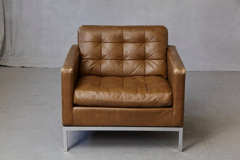 Florence Knoll lounge chair in tan leather with button tufted seat and back on a chrome-plated steel base. Labeled Art Metal - Knoll Corp., June 9 1971 The chair has some losses to the leather, which gives him some lovely patina. There is one