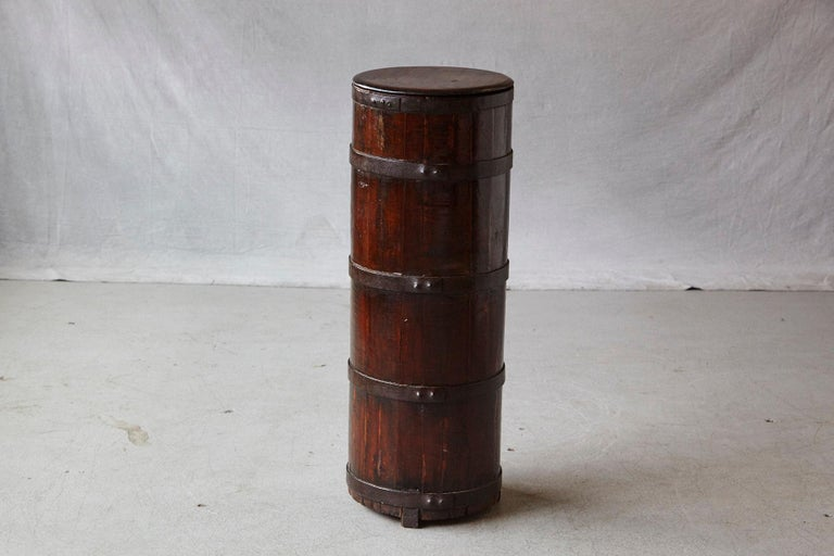 Late 19th century tall Chinese fir barrel from Zhejiang, circa 1870s. Very solid, iron banded fir wood construction. The lid has been professionally restored / replaced by a new lid which was carved after the old broken lid, in the 1970s in