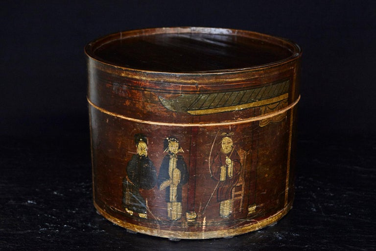 Very decorative late 19th century Chinese hand-painted and gilded round wooden hat box.