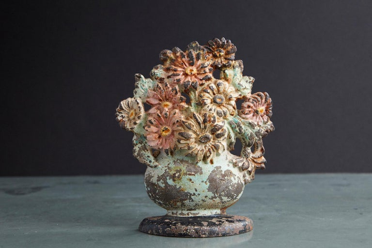 Lovely late 19th century cast iron hand painted polychrome flower bouquet in vase doorstop with it's original paint and fantastic patina. Heavy, solid piece of iron.