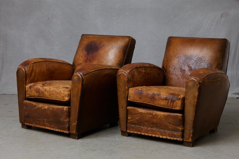 Art Deco Pair of Large Distressed French Leather Fauteuils or Club Chairs, circa 1930s For Sale