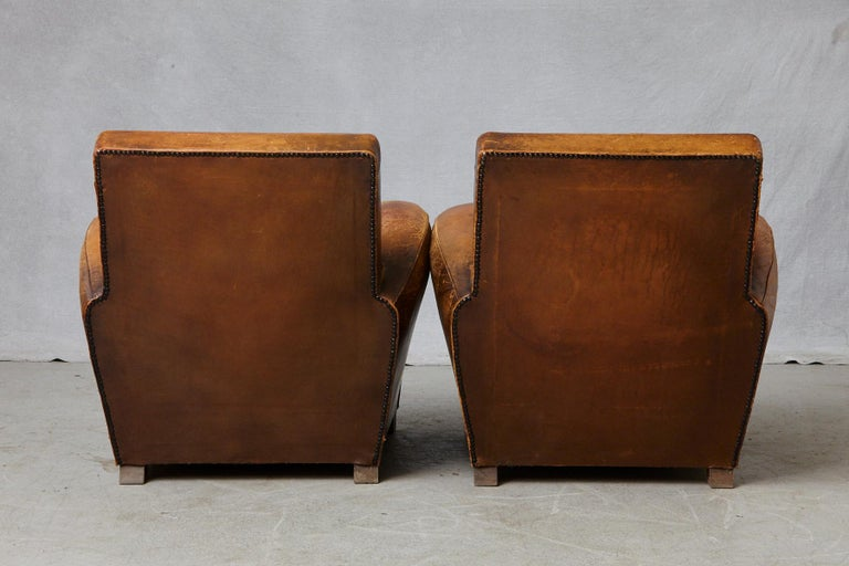 Mid-20th Century Pair of Large Distressed French Leather Fauteuils or Club Chairs, circa 1930s For Sale