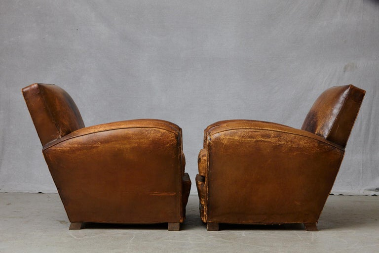 Pair of Large Distressed French Leather Fauteuils or Club Chairs, circa 1930s For Sale 1