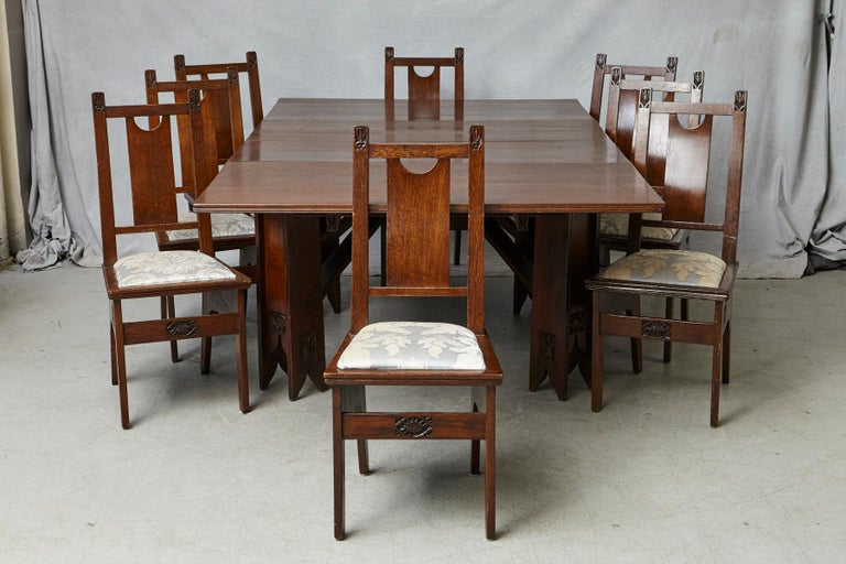 A very important and rare complete Art Nouveau dining room set, table and eight chairs, designed by the architect Ernesto Basile and manufactured by Ducrot Furniture, circa 1899 - 1909.  The extendable table and the eight chairs are in good