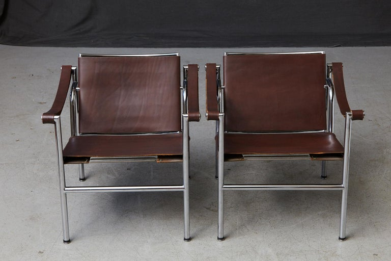 An extraordinary pair of original 'Corbu' armchairs, designed by Le Corbusier, Charlotte Perriand and Pierre Jeanneret, manufactured by Wohnbedarf in Switzerland and imported by Stendig Inc in the 1960s. The chair is now called the LC1 and is