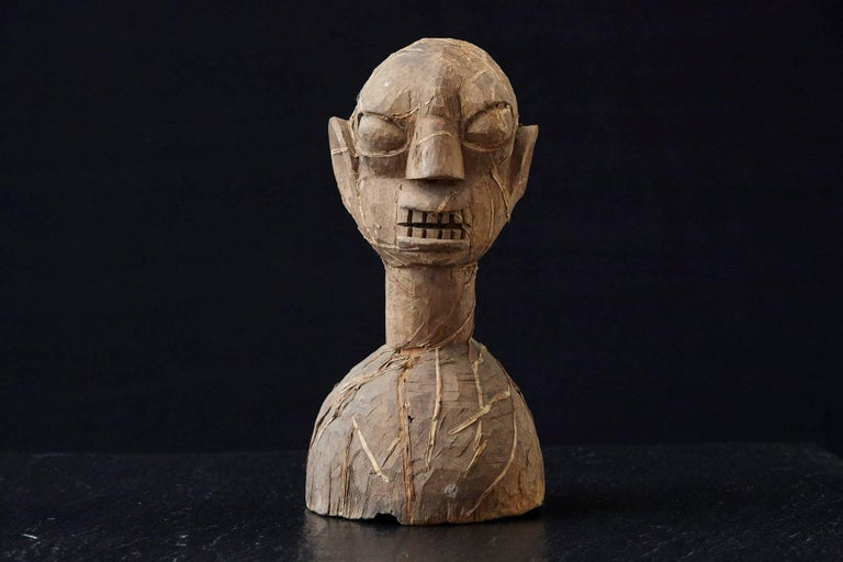 Wooden head of an Ooni of Ile-Ife, Yoruba People, Nigeria, circa 1930s. 