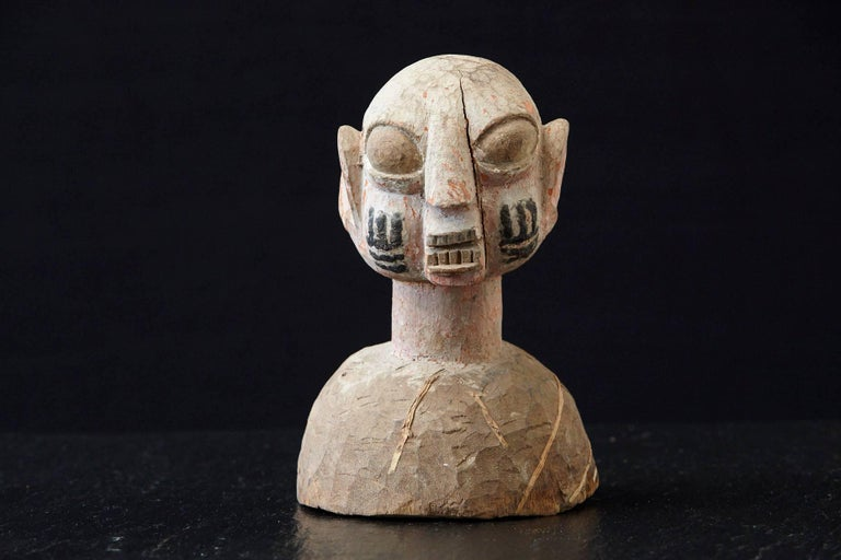 Wooden head of a wife of an Ooni of Ile-Ife, Yoruba People, Nigeria, circa 1930s. 
