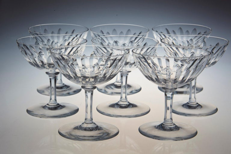 Rare set of eight Baccarat crystal champagne coupe in the 'Verone' pattern. The glasses are in a vertical cut bowl form with a six sided stem. This pattern was manufactured between 1954-1961. 