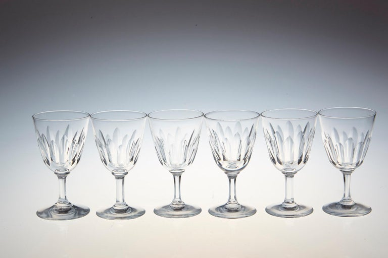 Rare set of six Baccarat crystal sherry or port glasses in the 'Verone' pattern. The glasses are in a vertical cut bowl form with a six sided stem. This pattern was manufactured between 1954-1961.