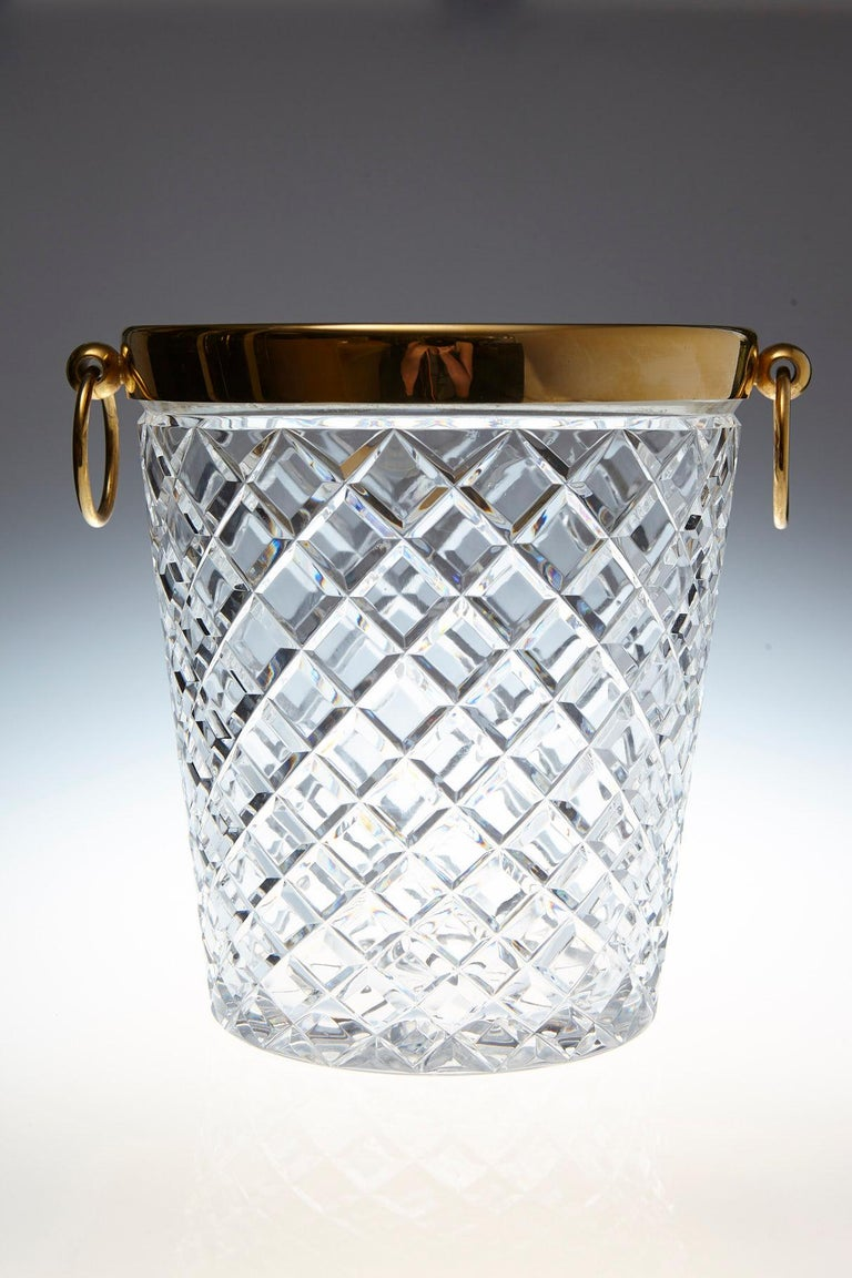 Impressive Belgian crystal and brass-plated ice bucket with diamond cuts and drop ring pulls.