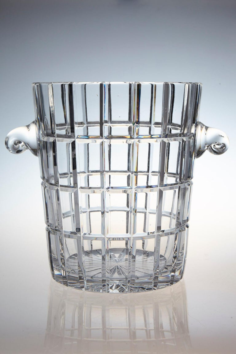 Extremely heavy and impressive French crystal wine cooler or champagne ice bucket with a graphic cut design and sculpted handles. The diameter without the handles is 7.75 inches. The ice bucket is in excellent condition. France, circa 1960s.
