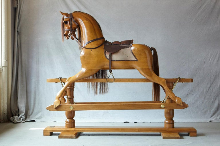 Impressive extra large 70 inches long! Custom made light oak rocking horse, hand-carved by Stevenson Brothers in Bethersden, Kent. The hand-carved oak horse mounted as a bow rocker, has been polished with natural bees wax to create a hard wearing