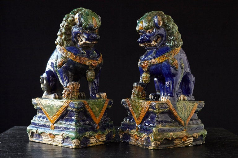 Lovely set of two late 19th century colorful Chinese Sancai glaze foo dogs.