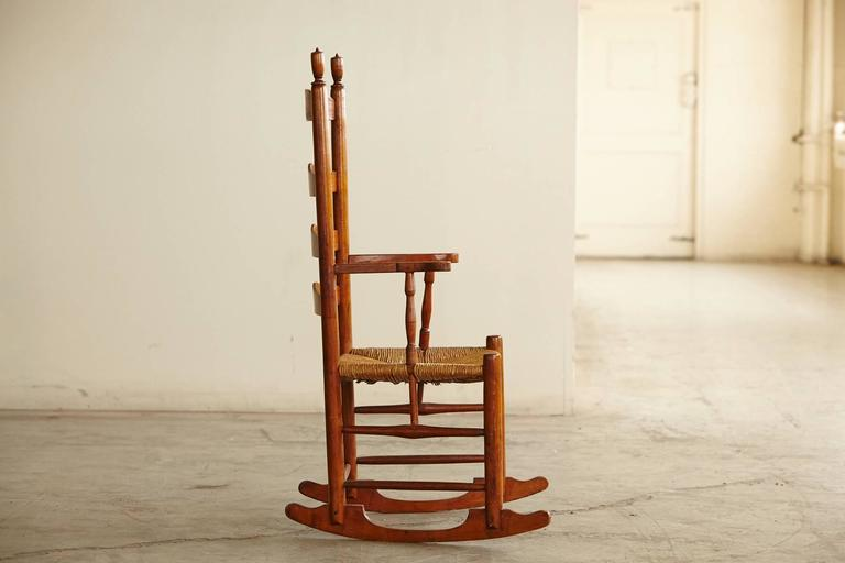 Early American Ladder Back Rocking Chair With Rush Seat