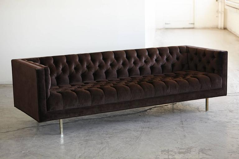 Very modernist, elegant tuxedo sofa with deep buttons and diamond like tufting in rich chocolate brown velvet and sleek brass legs. Custom made sofa with hardwood frame and attached seating and back cushion by Las Venus.