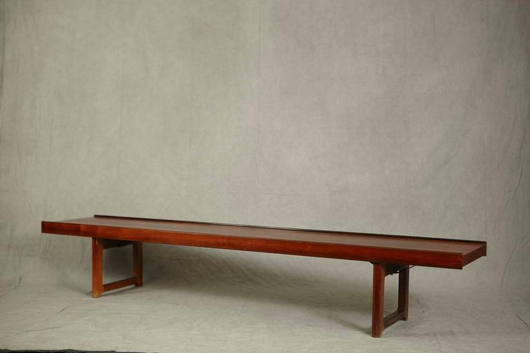 Versatile Scandinavian Modern rosewood bench or table titled 'Korbo', designed by Torbjørn Agdal for design company Bruksbo and manufactured by Mellemstrands Trevareindustri SA, all Norway, circa 1960s. Very minimalist style with lipped sides and