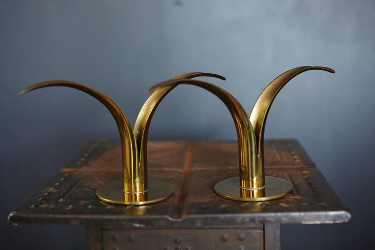Original, beautiful patinated pair of brass 'Liljan' candleholders designed by Ivar Ålenius Björk, manufactured by Ystad Metal, Sweden.  See engraved stamp on the bottom.