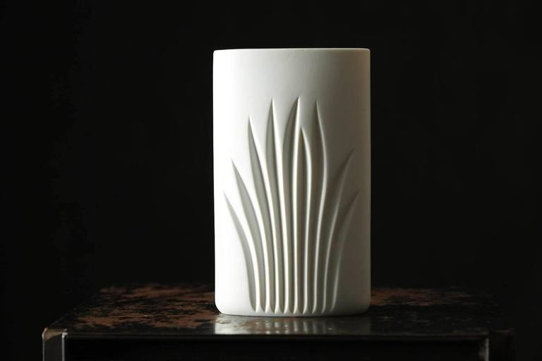 Beautiful white matte oval porcelain vase with Minimalist foliage designed by Claus Josef Riedel for Rosenthal Studio Line.