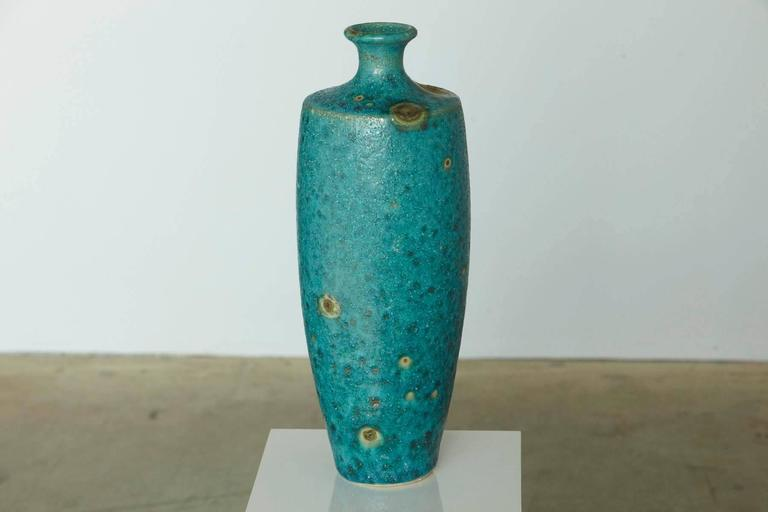 Beautiful large Italian modern ceramic fat lava glaze vase in turquoise blue with golden sunbursts in the style of Guido Gambone. Very good, almost excellent condition, no chips, flea bites, cracks or repairs.