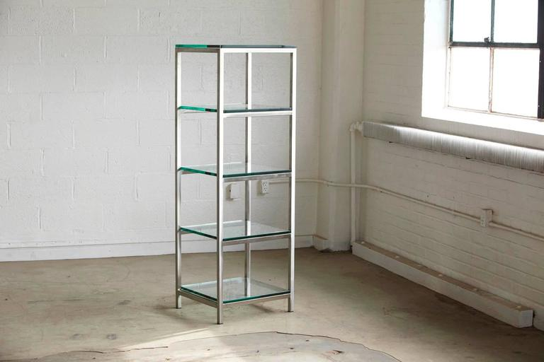 Modern brushed aluminium tube construction with 5 x 3/8 thick glass shelves. Sturdy and solid appearance caused through the heavy glass shelves. One of the glass shelves has a minor chip and loss of glass on the corner, which will not be visible