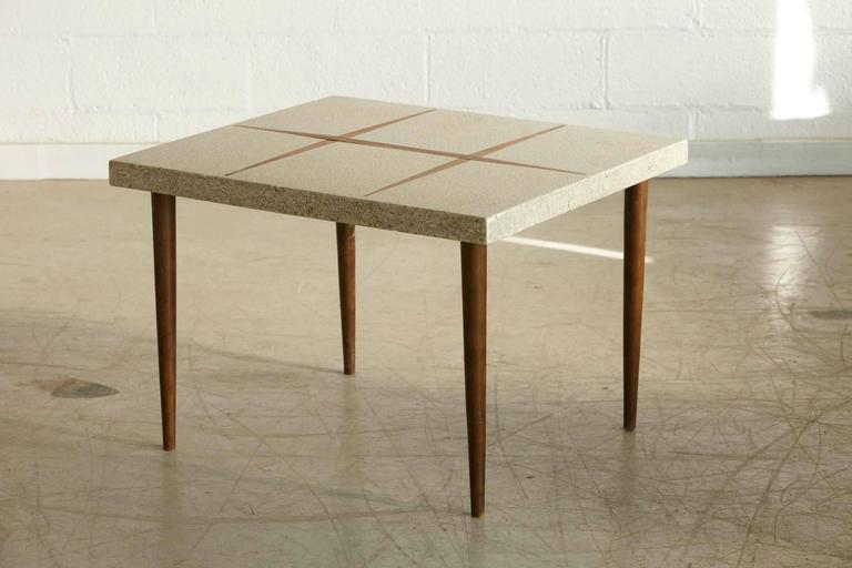 Mid-Century Modern rectangular side table with walnut inlaid cream colored terrazzo top on tapered walnut legs. Please refer also to our square terrazzo table in the same color and with walnut inlays.
