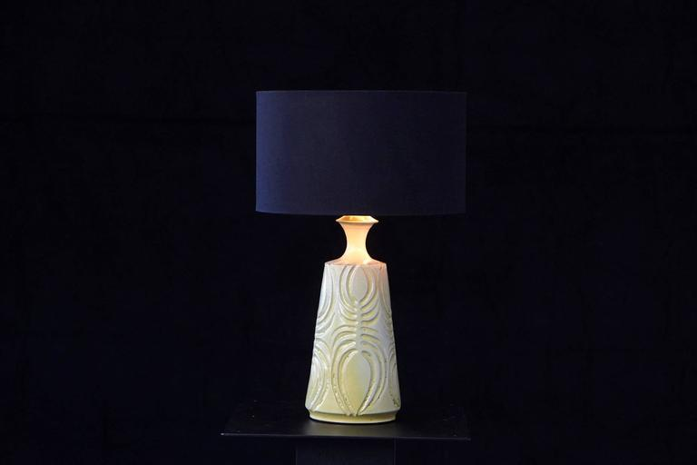 Gorgeous hand thrown ceramic lamp with a yellow glaze in from of a vase with tapering neck and flared rim. Deeply incised decorative lines. Hand-incised mark on the inside of the lamp, Robert Maxwell '71. The lamp came with a pre-drilled hole for