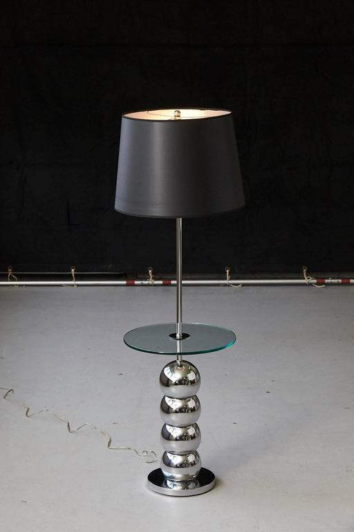 George Kovacs stacked chrome ball floor lamp with integrated glass table and new black / silver lined shade. The chrome is in excellent condition. Height to finial 54.50 in.