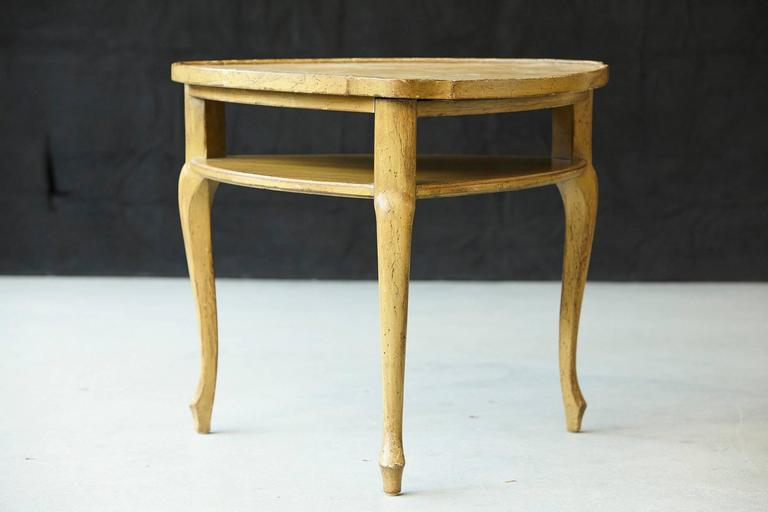 Distressed and well patinated French provincial triangle end table with embossed leather top.  Triangle form with additional shelf raised on cabriole legs. The table shows age but has somehow a very patina, please refer to the photos.