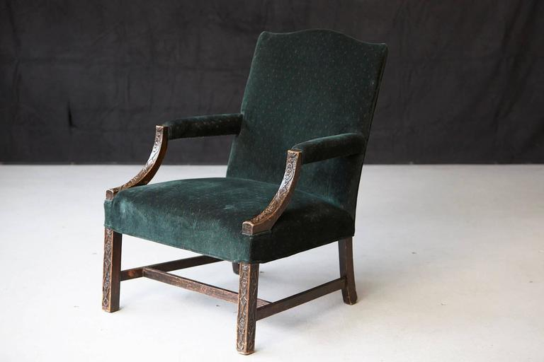 George III mahogany Marlborough chair, shaped arms with lovely delicate foliate carving. Square chamfered legs with H stretcher. Please note the splay of the rear legs.