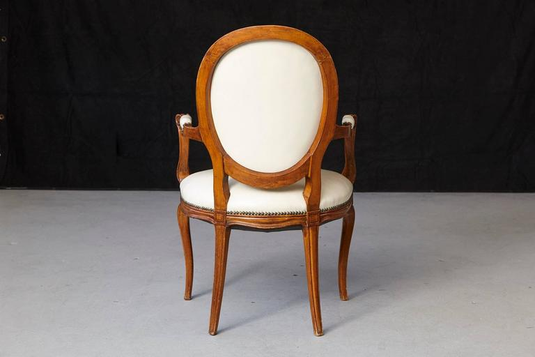 Brass Louis XV Style Walnut Fauteuil in Nail Trimmed Creme Leather For Sale