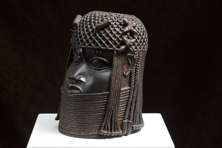 Benin Bronze Memorial Head from the Nelson Rockefeller Collection, 1978. The sculpture is stamped on the back.  'The Nelson Rockefeller Collection' was a line of about 100 high quality pieces of furniture and objects reproduced from the originals he