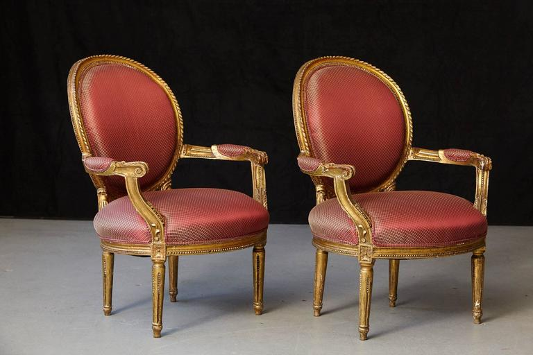 Gilt Pair of French Louis XVI Style Gilded Fauteuils For Sale