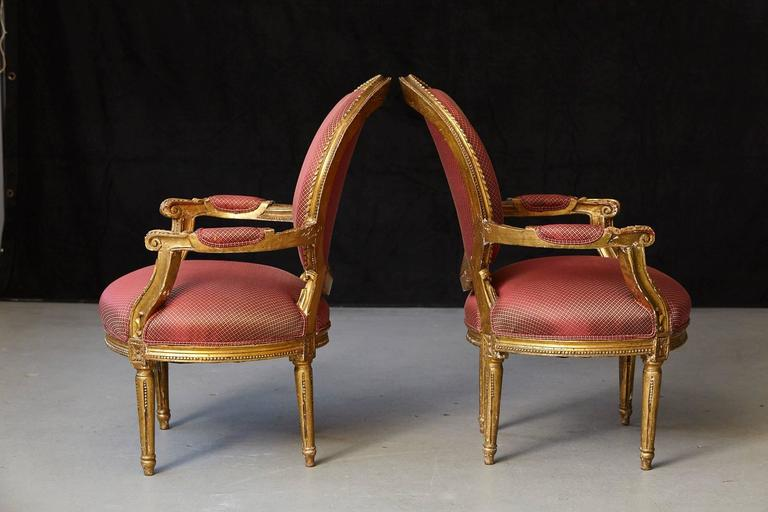 Late 19th Century Pair of French Louis XVI Style Gilded Fauteuils For Sale