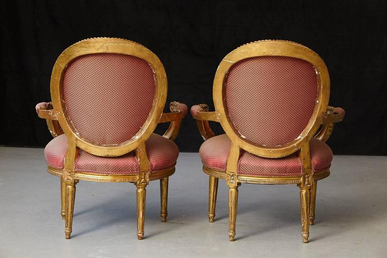 Wood Pair of French Louis XVI Style Gilded Fauteuils For Sale