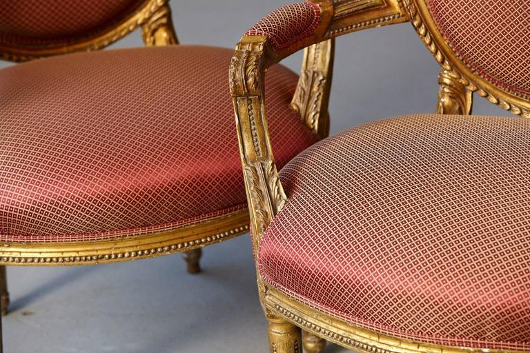 Pair of French Louis XVI Style Gilded Fauteuils For Sale 1