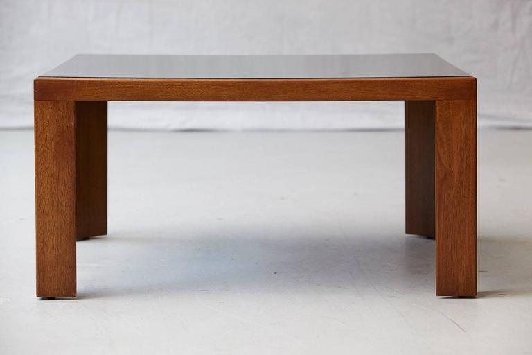 Elegant Dunbar walnut coffee or end table with triangle legs and black polished laminate top, model # 3374 designed by Edward Wormley. 