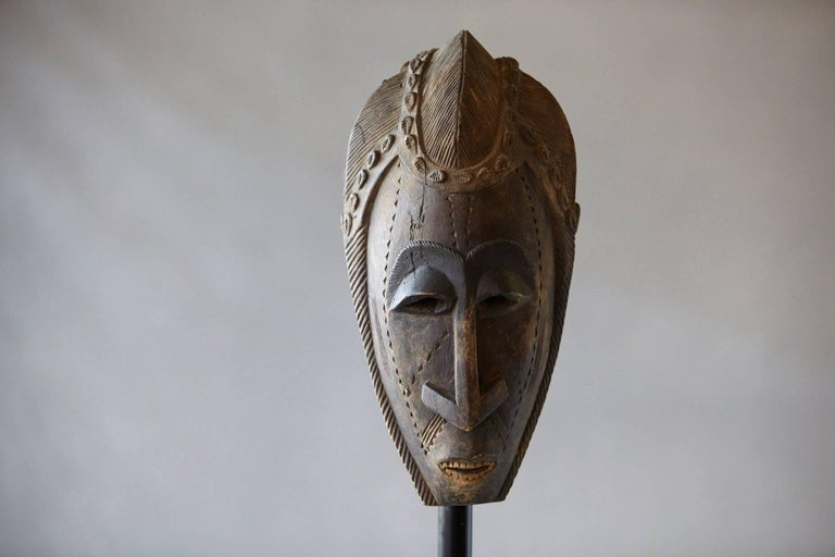 Beautiful decorative African hand-carved wood mask with graphic elements, circa 1960s This is a decorative item from the 1960s, it was made for export, it is not an antique tribal mask.