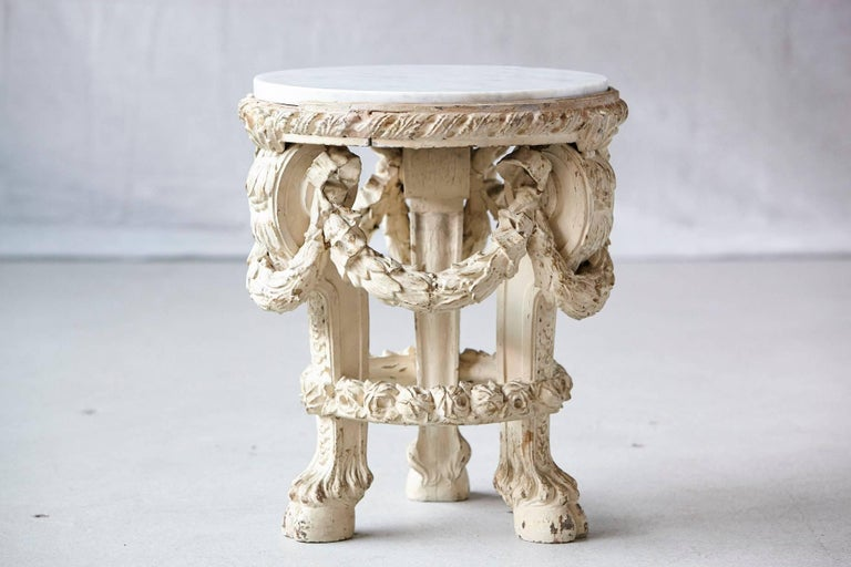 Beautiful Victorian carved side table with with rich ornamental details, paint finish and marble top. Some restoration to the table and marble, part of the tables rim is missing, please refer to detailed photos. A very charming table with a great