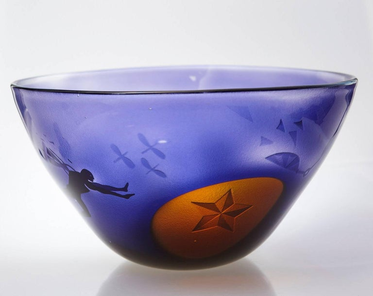 Outstanding blue art glass vase with sand blasted surrealistic, dream like sequences eternalized in glass.