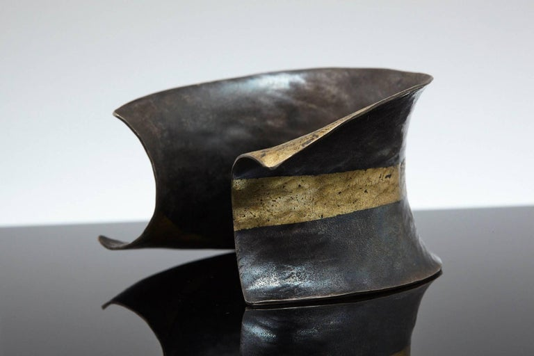 Exceptional hand-forged blackened iron fused with 22K Gold Cuff, designed by Pat Flynn.  As the piece is worn, the black iron lightens to a gorgeous gray. Inside length 2.24 in, inside width 2 in, opening gap 1.25 in  Pat's work has been featured in